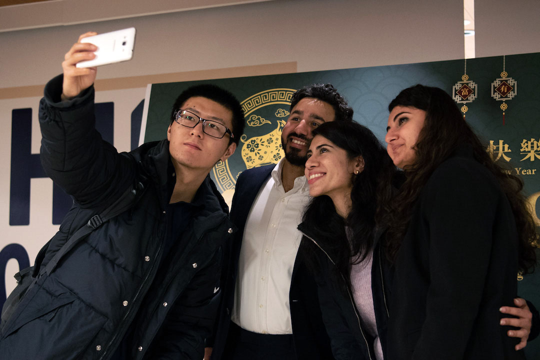 Group of students taking a selfie during a Lunar New Year celebration